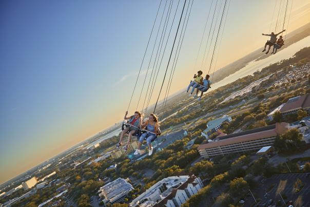 A wide shot of friends riding the Orlando Starflyer at ICON Park