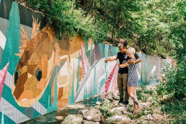 Couple admiring outdoor mural