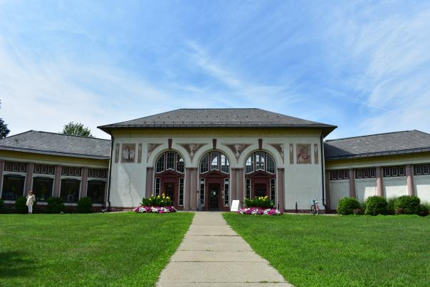 Saratoga Springs Heritage Area Visitor Center Exterior Shot, vivid green lawn and blue skies