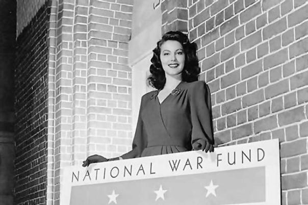 Ava Gardner holding a sign for the National War Fund