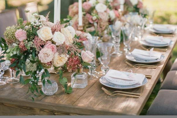 A tablescape set for  a small wedding reception outdoors on the water.
