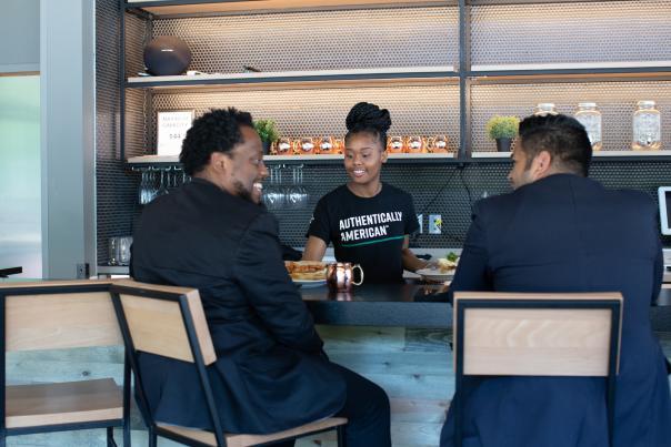 Gentlemen at the 40 Acres Soul Kitchen bar