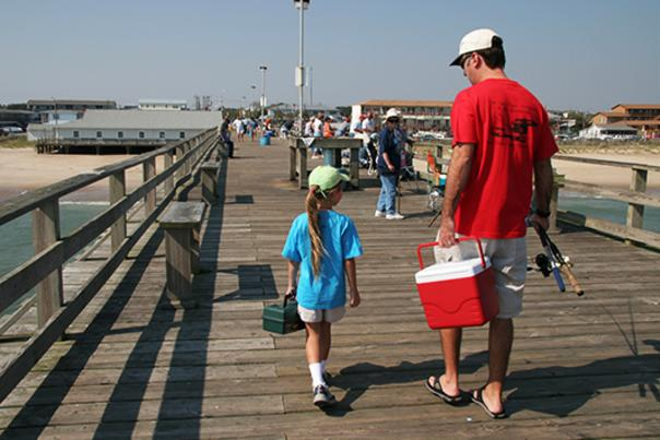 Dad and daughter on Kure Beach Fishing Pier