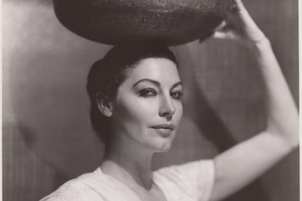 Ava Gardner holding water jug on head in character for Bhowani Junction