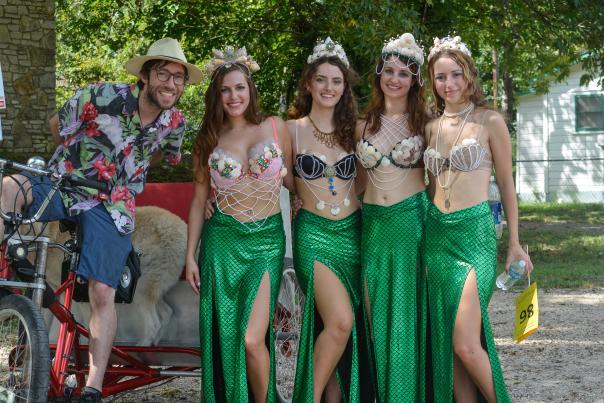 Several mermaids and a pedicap at the Mermaid SPLASH Downtown Promenade