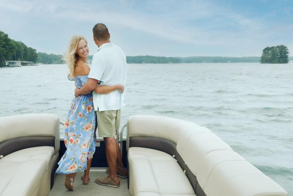 Man and woman embrace on boat cruise of Lake Sinclair.