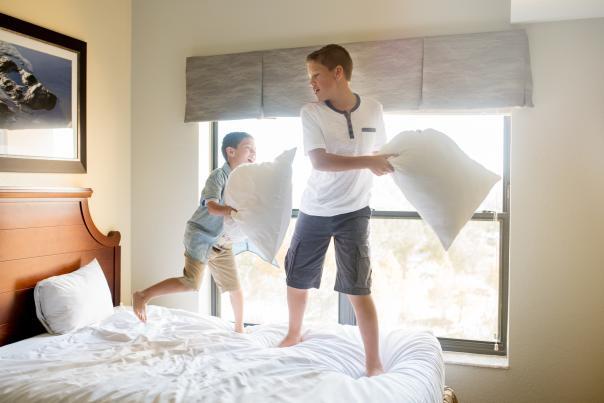 Holiday Inn Club Vacations® At Orange Lake Resort kids playing on bed in villa
