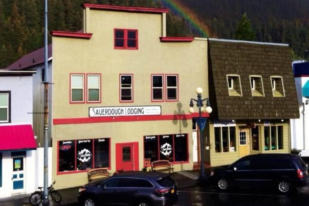 A rainbow frames Sauerdough Lodging building