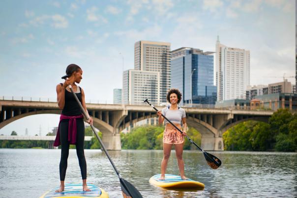 Stand up paddleboarding on Lady Bird Lake. Credit Visit Austin