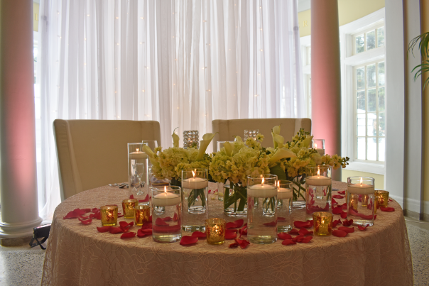 Table set for a wedding with flowers and floating candles