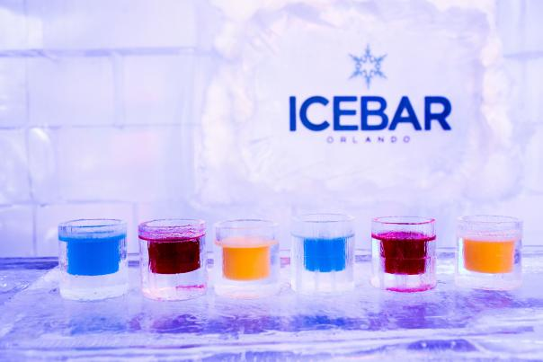 A variety of custom drinks line the ice covered bar at ICEBAR Orlando