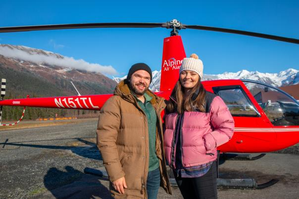 Couple in front of a helicopter
