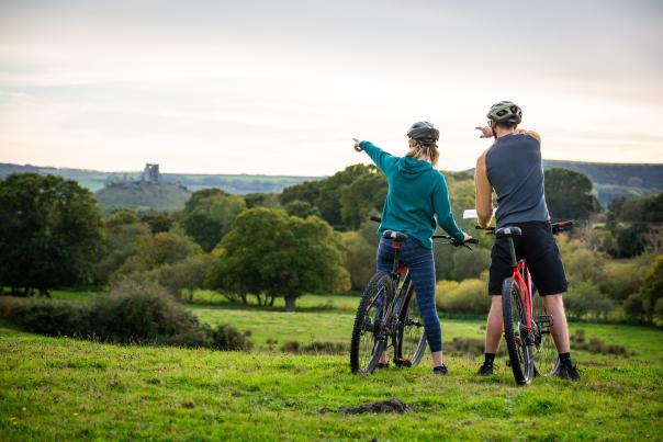 Two people cycling near Corfe Castle in Dorset