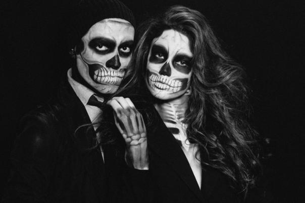 Couple wearing skeleton makeup