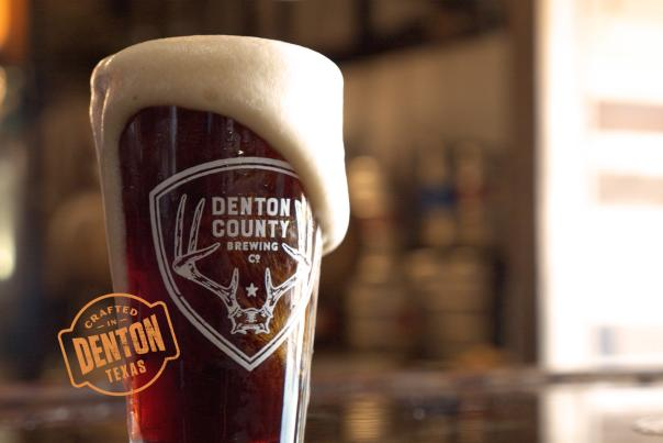 A pint from Denton County Brewing Company overflowing