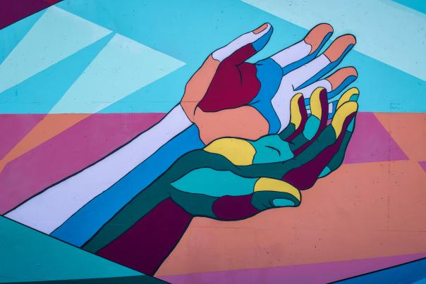 An artwork of hands with palms up.