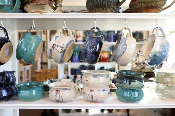 Pottery hangs on hooks at the Annapolis Pottery.