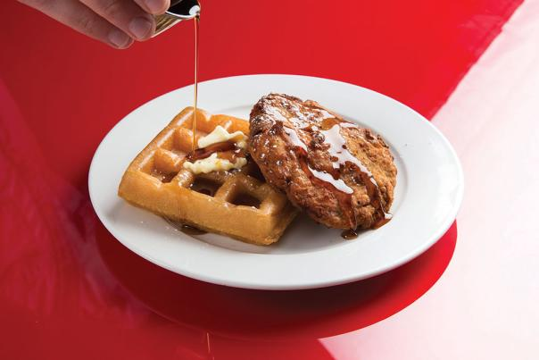A plate of chicken and waffles at DLUX in Madison