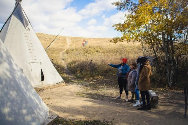 An interpretive guide shows Wanuskewin to visitors