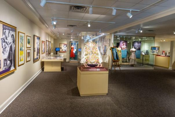Interior of the Ava Gardner Museum showing many exhibits from the front entrance of museum.