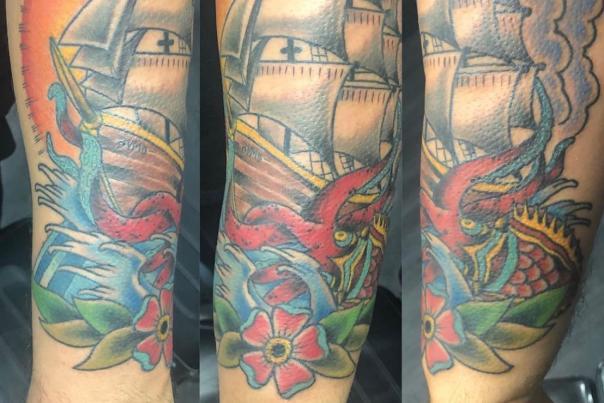 tattoo art of a clipper ship and sea dragon