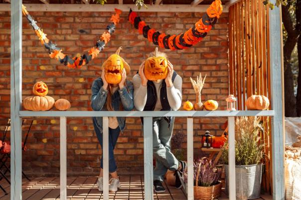 Couple posing with carved pumpkins