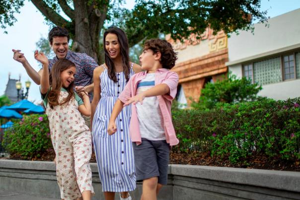 A family dancing outside in an Orlando area theme park.