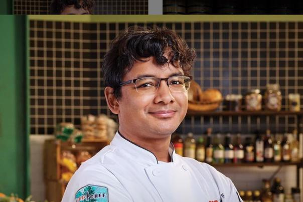 Chef Avishar Barua poses for competitor shot for Top Chef Season 18 on Bravo
