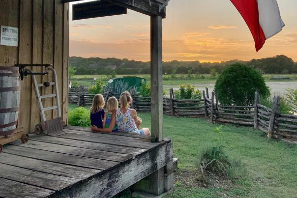 The Front Porch of the Pioneer Farms Main Office at Sunset. Photo by Michael Mckee.