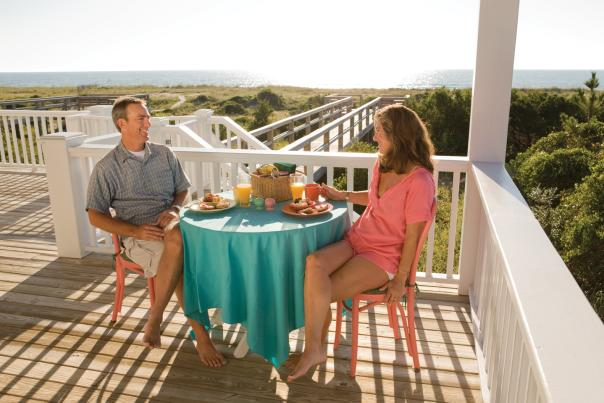 Couple Eating Breakfast on Porch Overlooking Wrightsville Beach