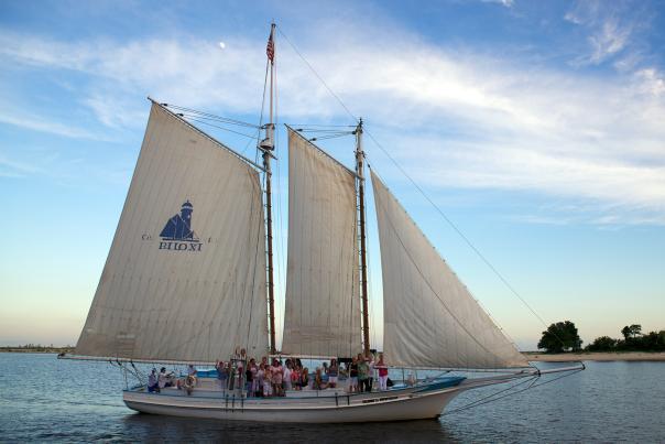 A Biloxi Schooner sails on the Mississippi Sound at sunset