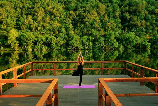 Yoga on the Yoga Deck. Courtesy of Lake Austin Spa Resort.