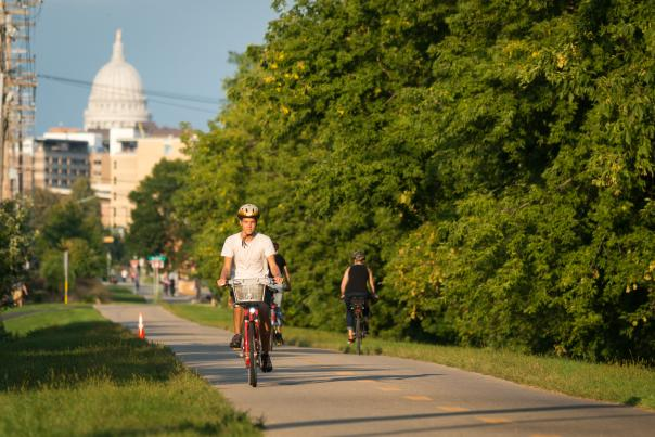 People enjoy one of Madison's many bike paths on a sunny day.