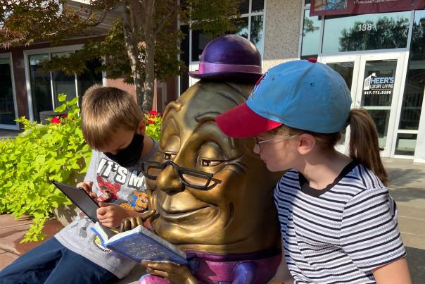 Kids reading by Sculpture Walk