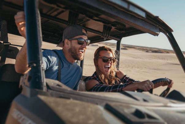 Scott and Collette of Roamaroo enjoy an ATV ride at the Syracuse Sand Dunes