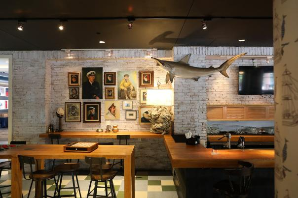 The new Trophy Room bar & restaurant exudes nautical charm and a throwback to college days with games like cornhole and foosball throughout the space
