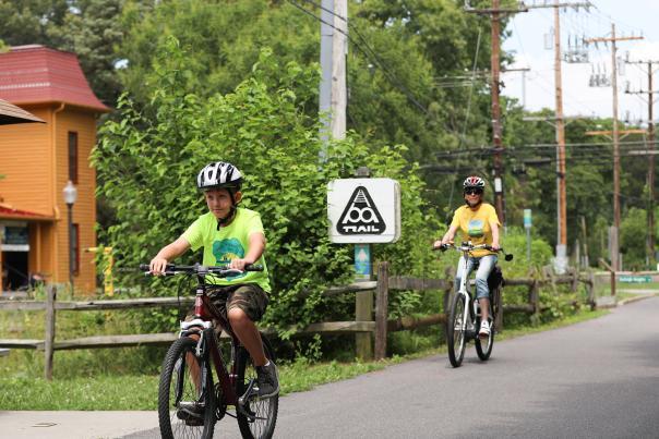 Woman and kid biking the B&A Trail.