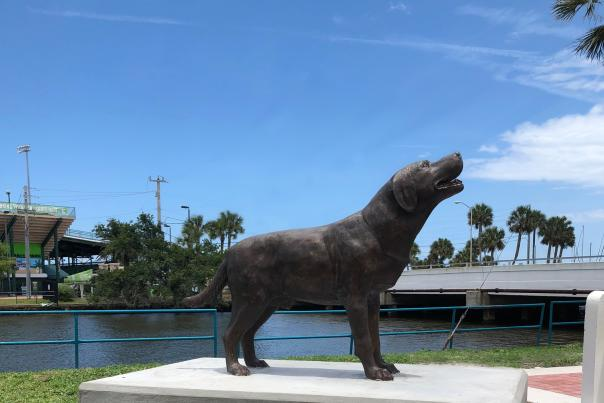 A statue of Brownie the Town Dog is perched proudly in Riverfront Park near the Sweetheart Trail in Daytona Beach