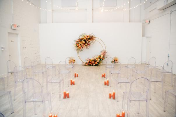 A micro wedding set up with fall vibes at Prism.
