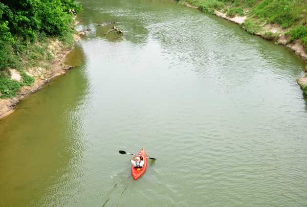 person kayaking in a river