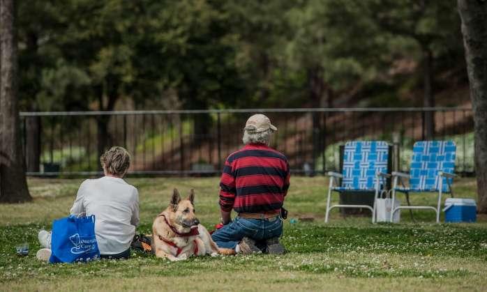 Family and dog enjoying a picnic