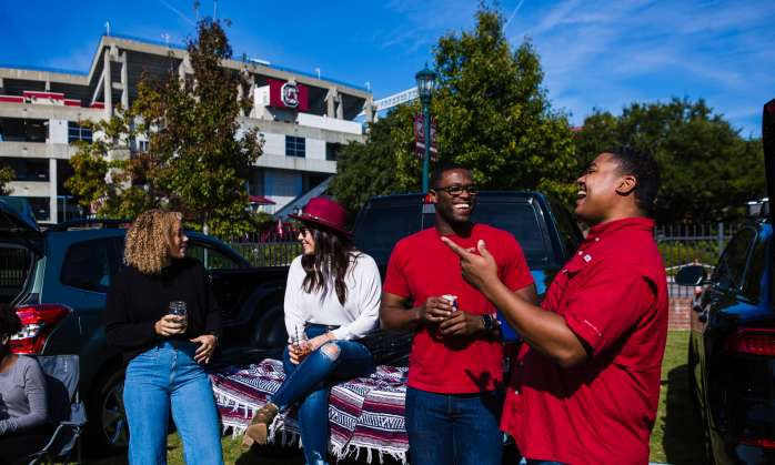 4 friends tailgating outside of Williams Brice Stadium