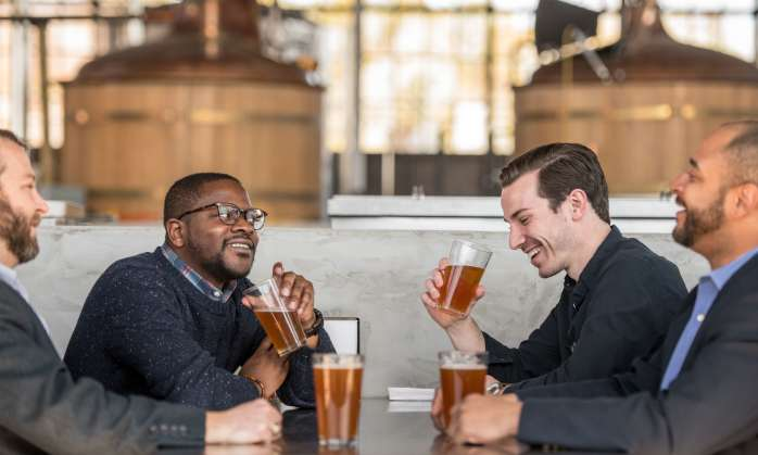 Group of men drinking beer at brewery in Columbia, SC