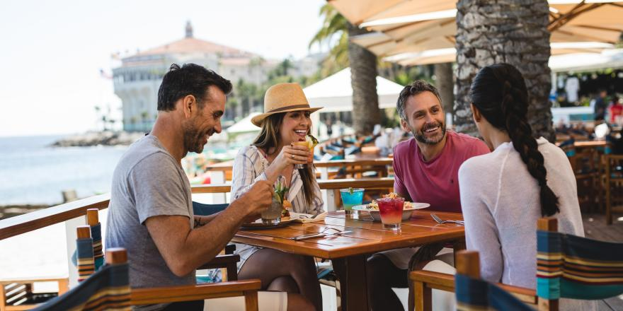 Couples dining outside at Descanso Beach Club on Catalina Island