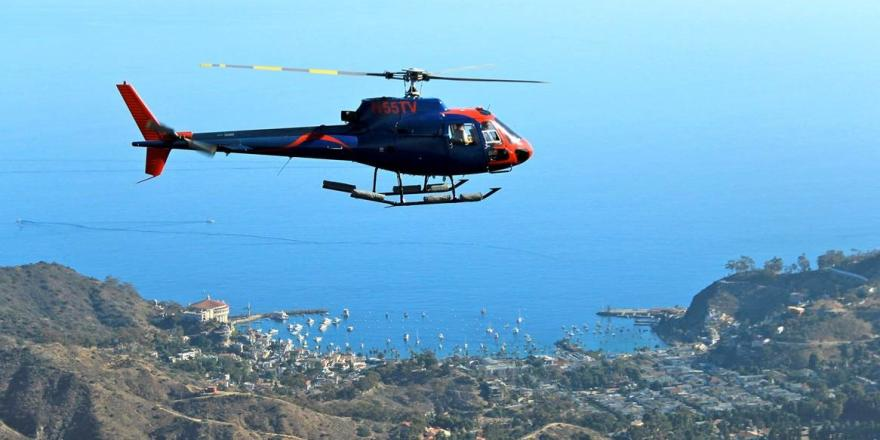 Helicopter flying over mountains on Catalina Island