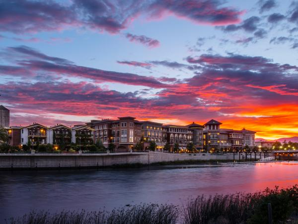 A bold sunset paints the sky over the Napa River