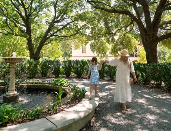 Mother and daughter walking through Historic Columbia Garden