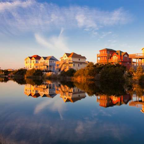 Homes sit on the water's edge, granting their occupants the best Outer Banks sunset views.