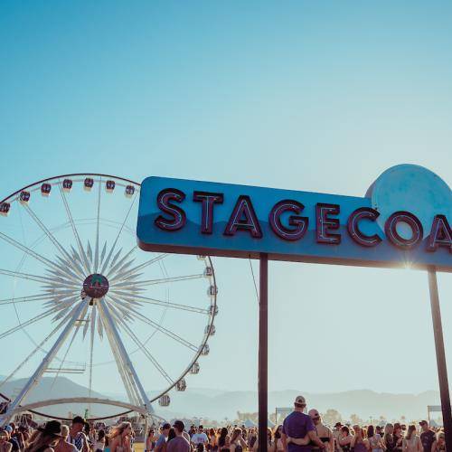 Stagecoach sign and ferris wheel.