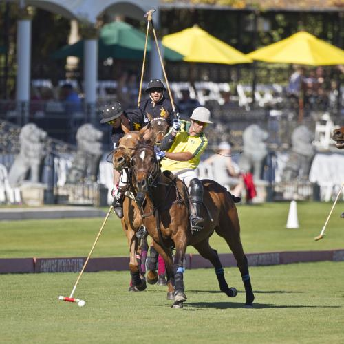 Two people playing polo.
